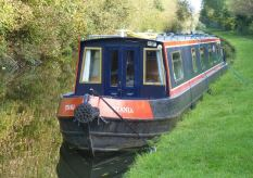 narrowboat moured on the bank of a canal